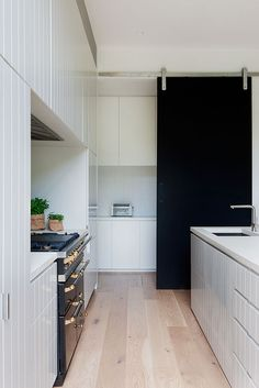 Robson Rak Architects and Made By Cohen – Elwood Scullery separated by sliding door