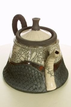 Raku teapot.  Pottery.  www.nitaclaise.com