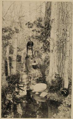 Ojibway woman carrying water, circa 1920   Minnesota Historical Society