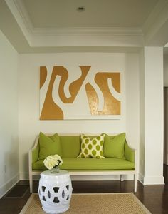 Contemporary coastal foyer with tray ceiling, Granny Smith Apple Green french settee, green ikat pillow, sisal rug with gray border, white rope stool and foyer art.