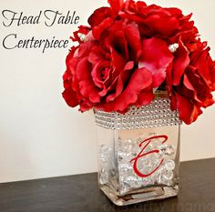 One Artsy Mama: Head Table Centerpiece - love the red and bling combo!