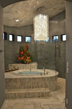 Beautiful chandelier and tub and ceiling and walls and....yeah, it's all cool