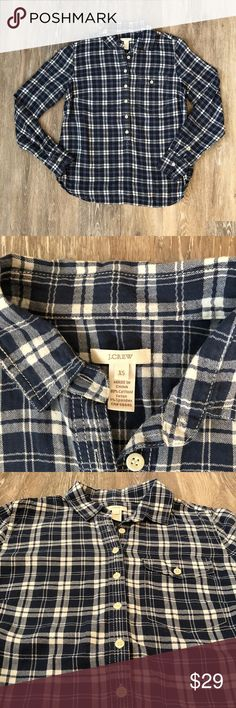 "J. Crew Popover Navy Plaid Excellent condition J. Crew Half Way Button Down Navy Plaid shirt. Buttons down the front 75% the way down. Long sleeves, chest pockets. Perfect for transition from winter into spring. 99% cotton 1% spandex. 27"" long, 19"" pit to pit. No trades, offers welcome. J. Crew Tops Button Down Shirts"