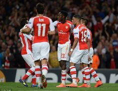 Welbeck (centre) is congratulated by his Arsenal team-mates after netting his first ever Champions League goal for Arsenal at the Emirates Stadium on Wednesday