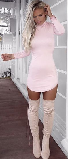 Very sexy long boots and dress.  Pinterest: pearlxoxoxo