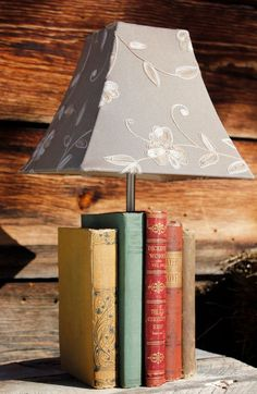 Create furniture pieces like lamps, side tables, or coffee tables by piling up old books. Be sure to glue the books together so you won't have to stack them up again if the pieces ever topple over. Find more DIY lamp inspiration, tutorials and supplies at www.ilikethatlamp.com