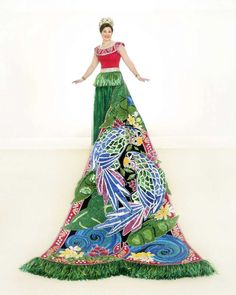 Allison Timberlake Biedenharn, Duchess of Tahitian Treasures: Parrots, tropical mountains and clear streams are seen in this gown and train depicting Tahiti. The gown features a collar of jeweled sea bird symbols beaded with Indian pink crystals. The train's parrots are beaded in green bugle beads and chartreuse twisted bugle beads. She is the daughter of Mr. and Mrs. Lawrence Tucker Biedenharn.