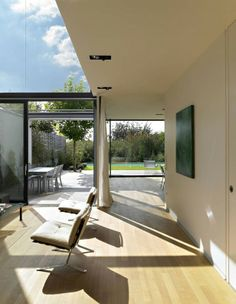 Modern Contemporary Exterior With Glass Large Window Domination: Soft Brown Chairs And Glazed Table In Wooden Floor ~