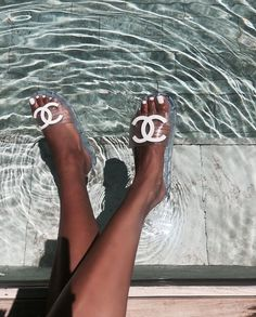 Poolside #foundonweheartit #mood #fashion #style #chic #happy #poolside #pool #feet #slides #sandals #chanelshoes #chanelslides #aqua