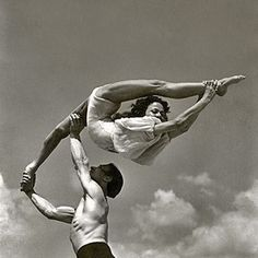 1950s vintage acrobats performing at the beach