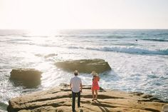 How cute are they?! | See more of this California coast engagement session here: http://www.mywedding.com/articles/james-and-monicas-beachy-la-jolla-ca-engagement-session-by-lets-frolic-together/