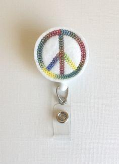 Rainbow Peace Sign Felt Badge Reel  by SimplyReelDesigns on Etsy, $6.00