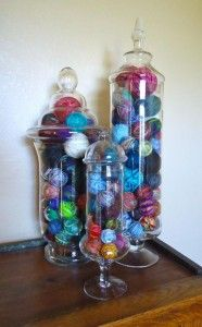 Scrap yarn balled up and stored in glass jars.