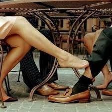 Footsies under table