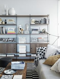 Create a personal bookshelf with this shelf system here. The shelves are removable, so you can quickly and easily customize the bookcase to the things you want in it.