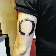 Male Triceps Black Horse Shoe Tatto