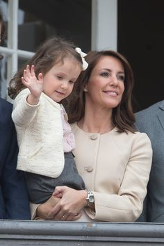 Princess Marie of Denmark with Princess Athena of Denmark, attend Queen Margrethe II of Denmark's 76th Birthday Celebrations at Amalienborg Palace, on April 16, 2016, in Copenhagen, Denmark