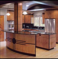 the kitchen was designed around a recurring theme throughout the homecircles there were circles on the doors round windows and circles on the art deco kitchen lighting