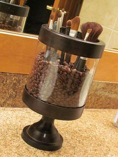 Great use for an old hurricane - fill with coffee beans and store makeup brushes