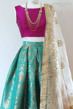 Beautiful Dress With three Colour Combo with the pretty necklase.And one side dupatta is looking Awsome.Crop Top with skirt great idea.