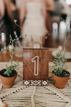 Wooden wedding table number   Image by Brett & Jessica