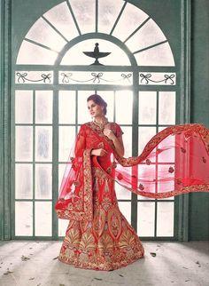 Red net and silk designer lehenga choli with diamond work embellishments.