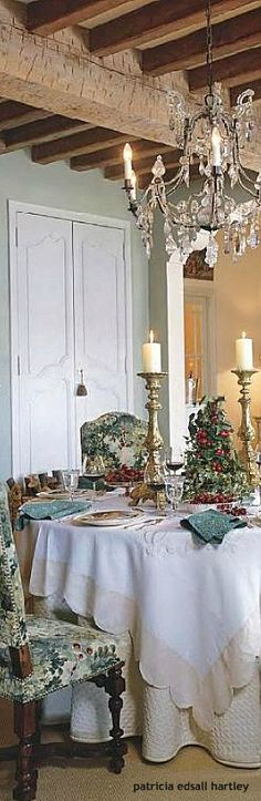 .crystal chandelier...tablecloths...candlelit dinners,nightly... JC/M: Appealing storage doors.