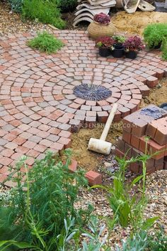Building a patio with brick pavers in garden construction