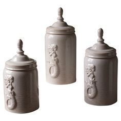 Add a coastal-chic touch to your entryway console table or master suite vanity with these ceramic canisters, showcasing a mermaid motif and finial top.