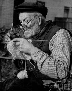 'Everybody's knitting - Mr Mark Whatmough of Harmondsworth in Middlesex, who is over 70, has joined the ranks of the knitters'. Elderly man knitting as part of the war effort during WWII, 31 October 1939.