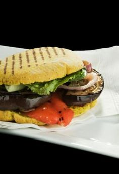Eggplant may be low in calories but it ranks high in flavor, texture, and versatility in the vegan kitchen. These Mediterranean-style vegan sandwiches feature sun-dried tomatoes, roasted eggplant, and red pepper slices. Serve this yummy vegan recipe for l