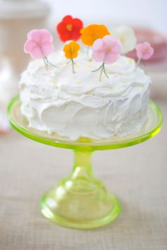 A lemon cake with lemon curd filling is iced with whipped cream-cheese icing spiked with fresh lemon zest.   Holiday...with Matthew Mead