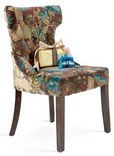 Your table deserves a fabulous Peacock Hourglass Dining Chair from Pier 1