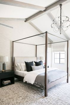 A Modern, Industrial, and Family-First Home - Canopy bed in the master bedroom + large rug in the bedroom + wooden beams on a vaulted ceiling + extra long lumbar pillow Bedding Master Bedroom, Modern Master Bedroom, Modern Bedroom Design, Master Bedroom Design, Large Bedroom, Home Decor Bedroom, Bedroom Furniture, Wooden Bedroom, Modern Canopy Bed