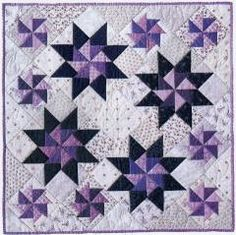 "All Star - The Creative Pattern Book, 1998. Designed and pieced by Judy Martin. Quilted by Jean Nolte. 29"" x 29"". An alternate colorway in a larger size is also presented."
