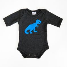 Introducing the  Glammic™ onesie! Currently available in Size 9-month with 3/4 length sleeves.  In charcoal, with a hand cut & sewn T-Rex applique. $35