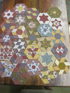 Mum's hand-pieced hexagons by thornberry, via Flickr