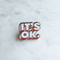Im OK. Youre OK. Its OK. Spun-cast pin in shiny silver-tone metal with recessed white, pink & red enamel, with white rubber clutch. Approx. 1 x