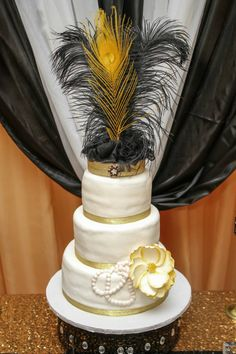 Find this Gatsby Cake Topper at https://www.etsy.com/listing/254400677/gatsby-black-and-gold-feather-cake?ref=shop_home_active_21 #Gatsby #caketopper #Roaring20s