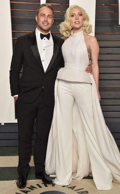 Taylor Kinney & Lady Gaga from Vanity Fair Oscars Party 2016: What the Stars Wore  In Giorgio Armani (Kinney) and Brandon Maxwell (Gaga)