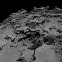 This OSIRIS narrow-angle camera view was captured by Rosetta on 22 September 2014 from a distance of 28 km. It focuses on the irregular, fractured and stratified morphology of the Seth region of the main body. A wide terrace is seen in the foreground with a deep pit revealing the inner layered skeleton of the comet nucleus.