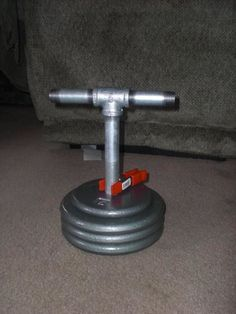 We made one of these. You can even adjust the weights on it.  homemade kettlebell