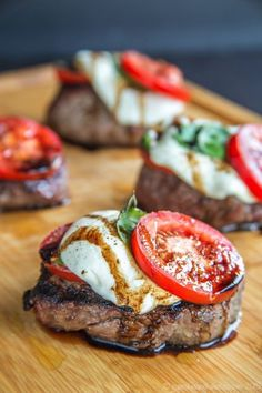 Caprese Grilled Filet Mignon - top perfectly grilled steaks with the classic salad of tomatoes, fresh mozzarella, and basil for a perfect summer dinner
