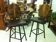 1 Pair of wrought iron western hair on hide barstools $100 each!!!