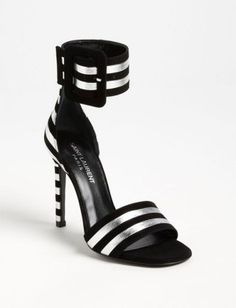 695d07d066d2 Blackout velvet sets off the measured metallic of a modern ankle-cuff  sandal balanced on a slim heel. Adjustable strap with buckle closure.  Leather and ...