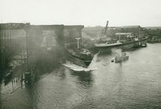 This photograph of the launch of the 'Aghios Nicolaos' by William Doxford & Sons Ltd (TWAM ref. DS.DOX/4/PH/1/805/3/2) shows different stages of shipbuilding with two vessels under construction on the slipways, the 'Aghios Nicolaos' sliding down the ways and the vessel 'Dona Evgenia' at the fitting out quay.