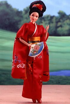 Konnichiwa (hello) from Japan. Japanese Barbie doll wears a stunning red kimono with spring flowers. Her black hair is pulled away from her face and tied with a red and white hairband. Sayonara (goodbye)!