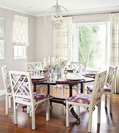 Playing off the graphic shapes of the lattice-style chairs, honeycomb-print fabric covers the large picture window while Roman shades in the same fabric suit smaller windows, a solution that brings about cohesion to the different-size windows. Maintaining the light and airy feel, the mostly white drapes are unlined, allowing light to filter through.