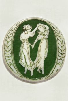 Vintage Cameo button with two women dancing