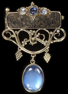 Reginald Pearson. Arts and Crafts brooch, gold, with with sapphire and moonstones, c. 1912.   V&A Search the Collections